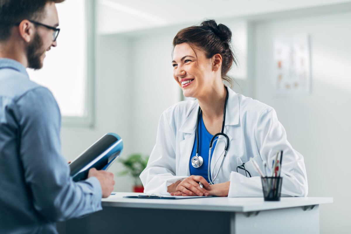 Picture of a doctor talking to a client in a clinic